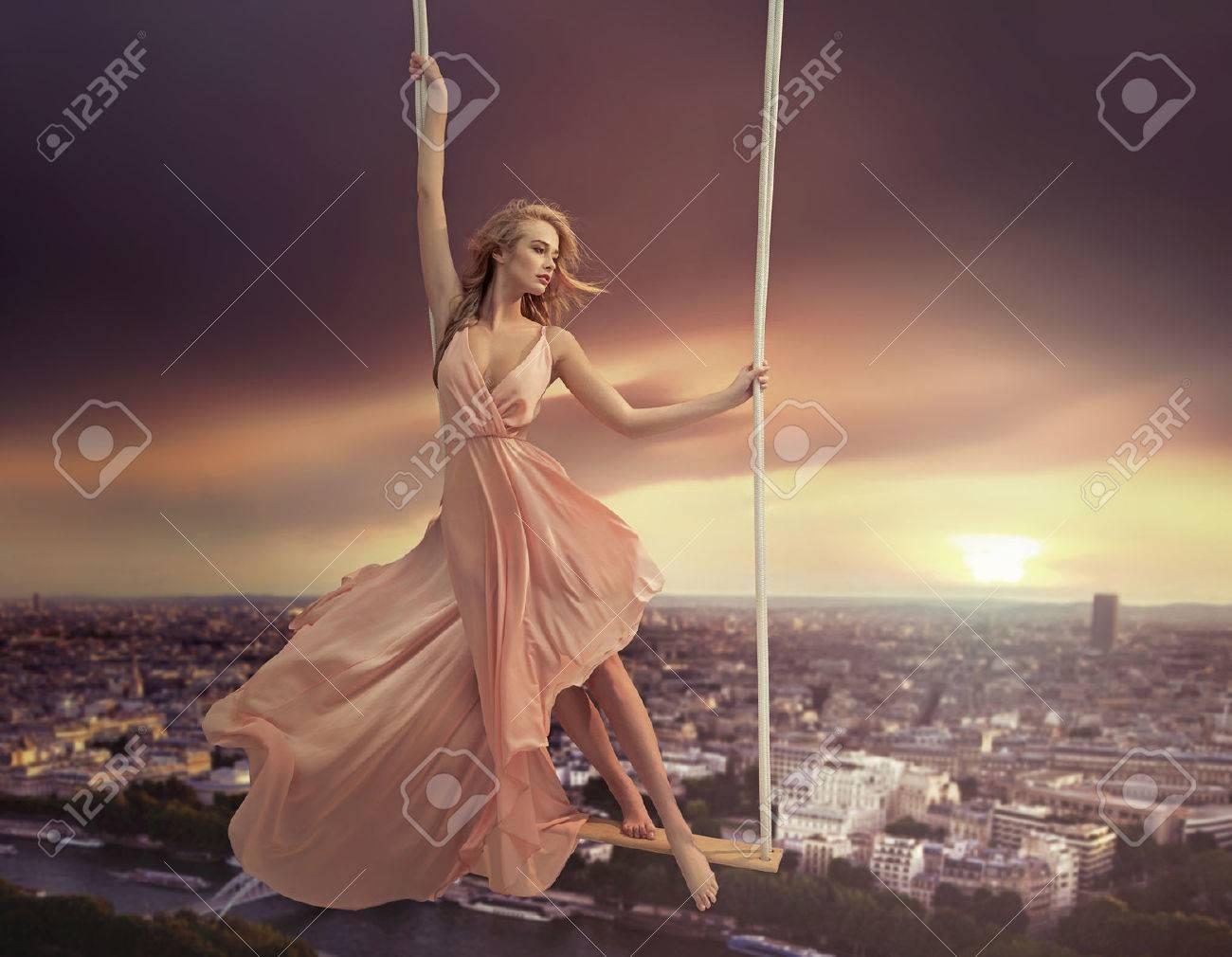 Adorable woman dangling above the city Archivio Fotografico - 51039848