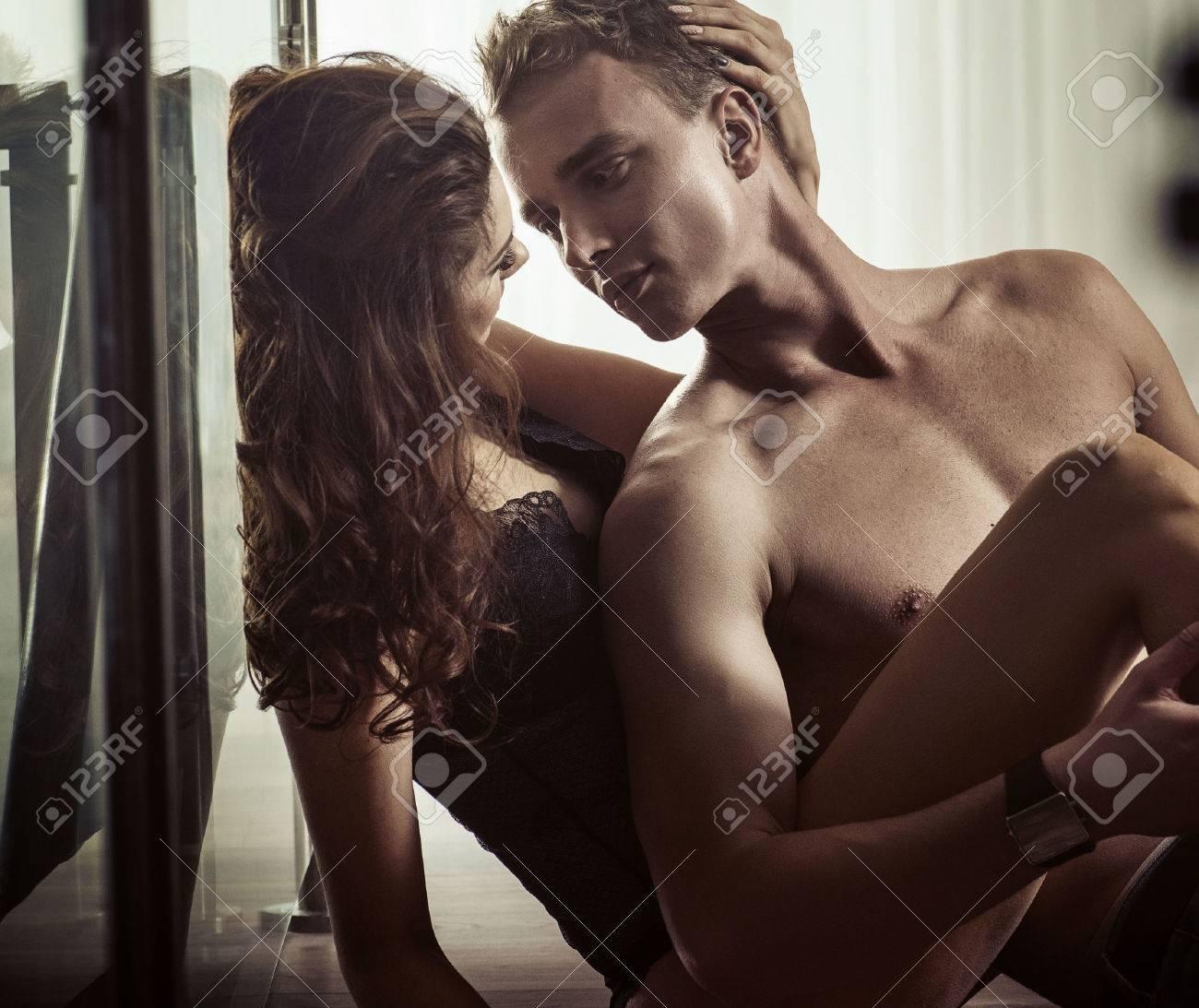 Young brunette woman caressing her boyfriend Archivio Fotografico - 52915142