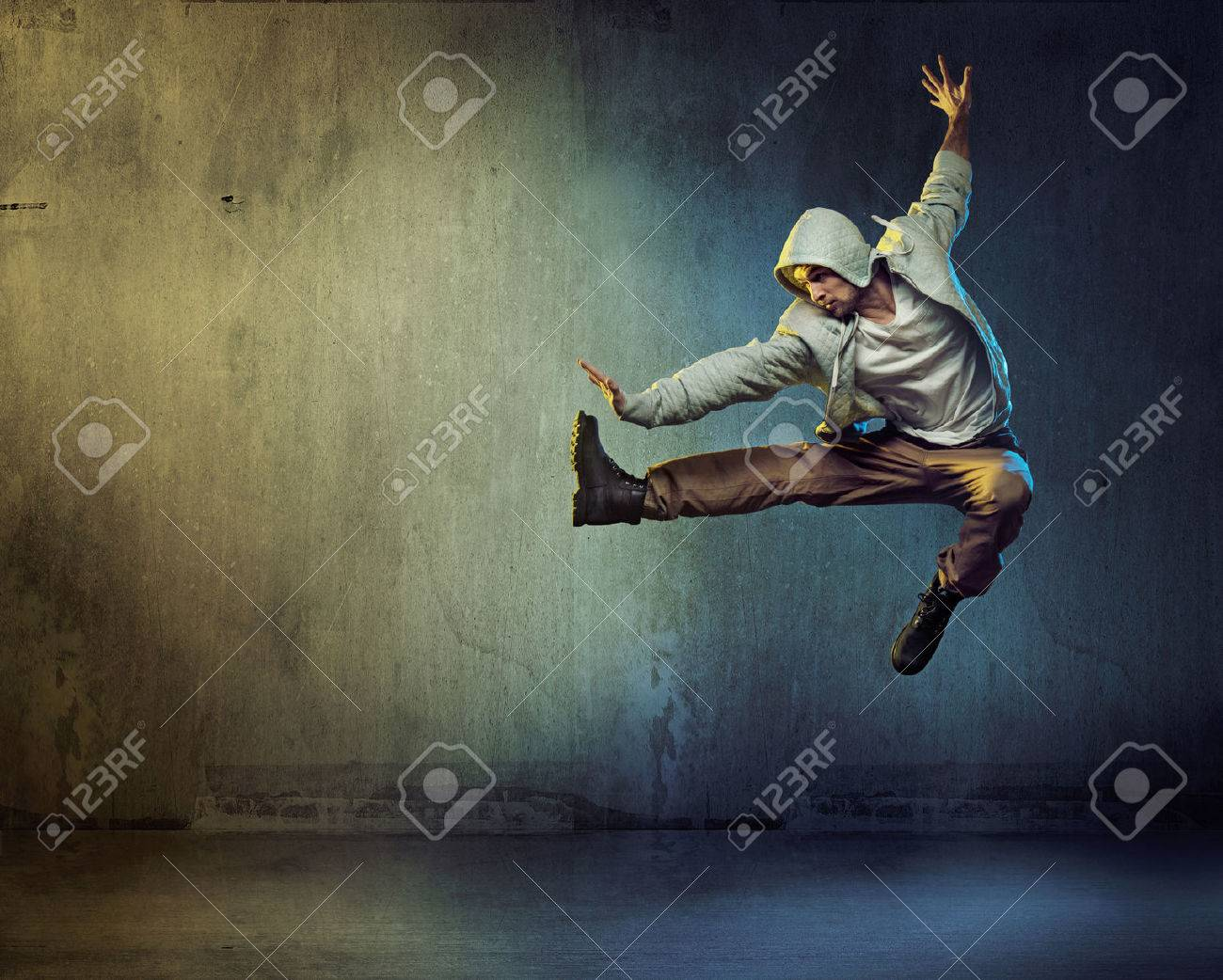 Athletic dancer in a super jumping pose - 53140584