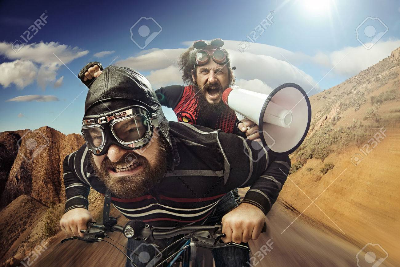 Funny portrait of a tandem of bicyclists Archivio Fotografico - 53129350