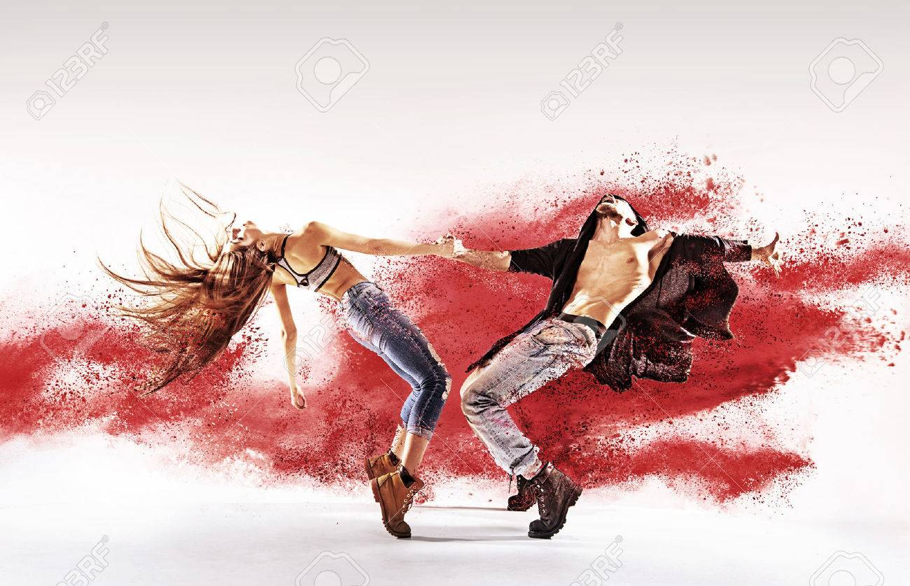 Talented young dancers sprinkling red sand - 53140581