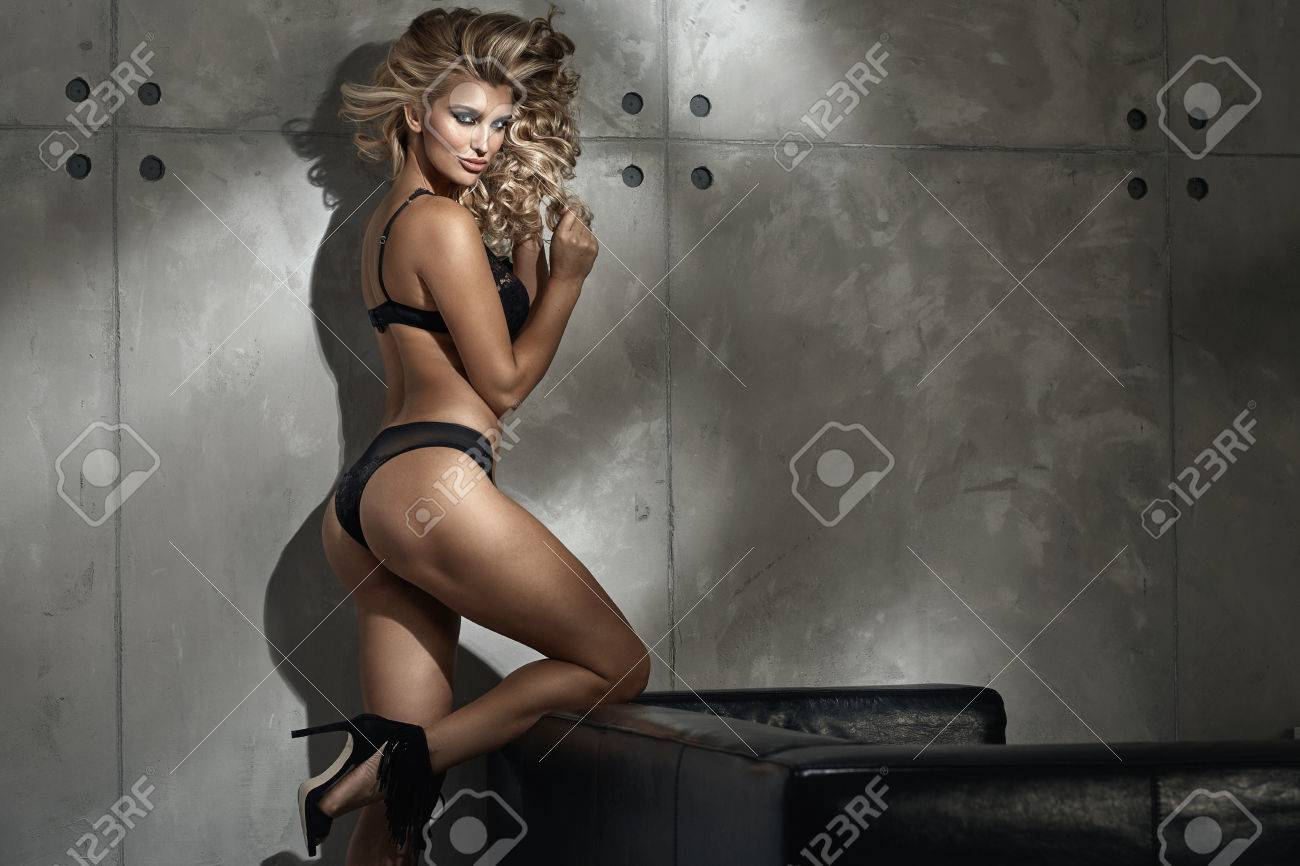 d26b906acd8b Sensual blond woman wearing black lace underwear Stock Photo - 55761700