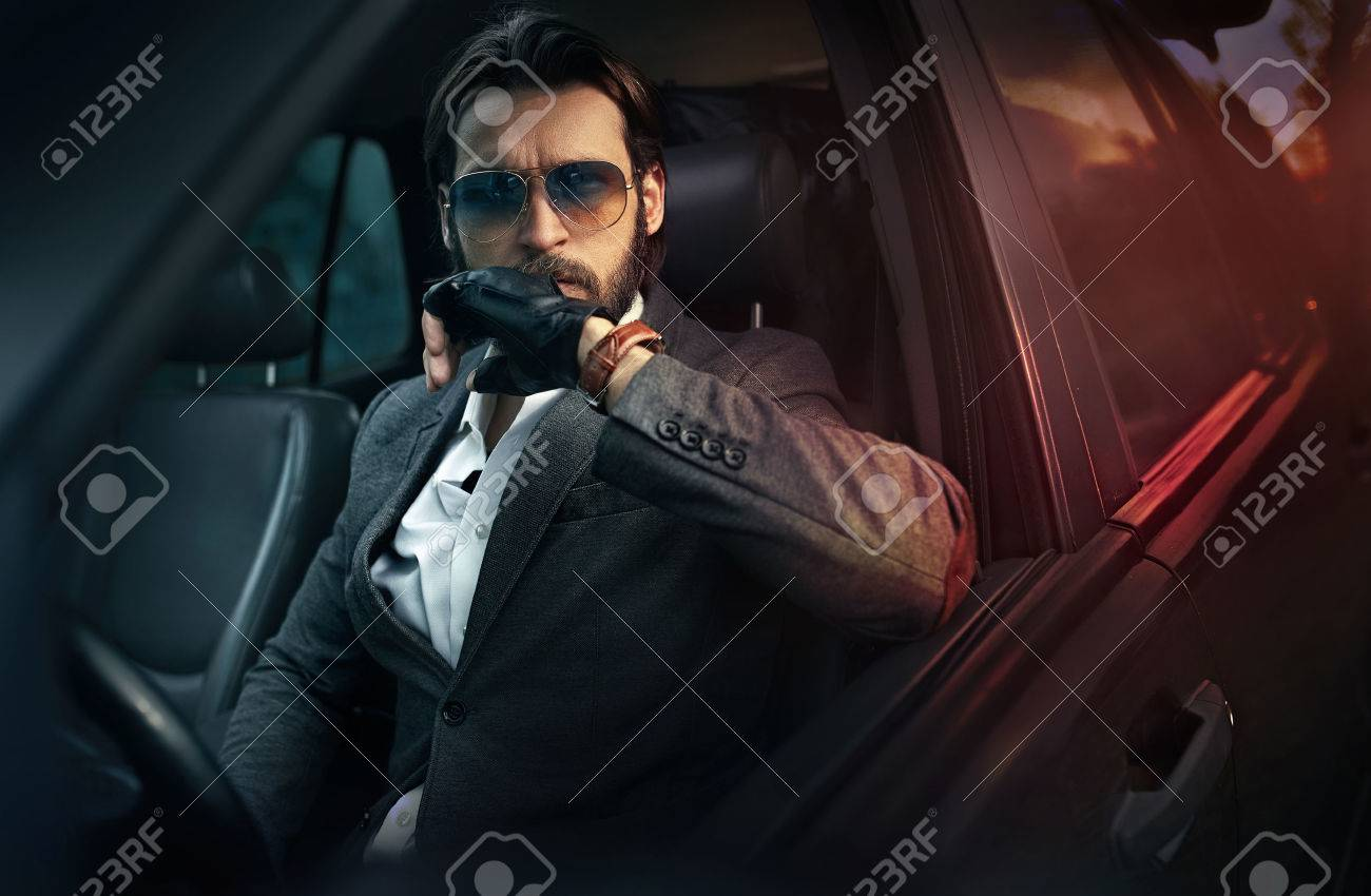 Handsome fashion man driving a car Archivio Fotografico - 55393002