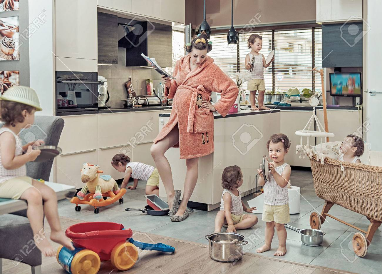 Conceptual image of exhausted mum with her misbehaving child Archivio Fotografico - 67518198