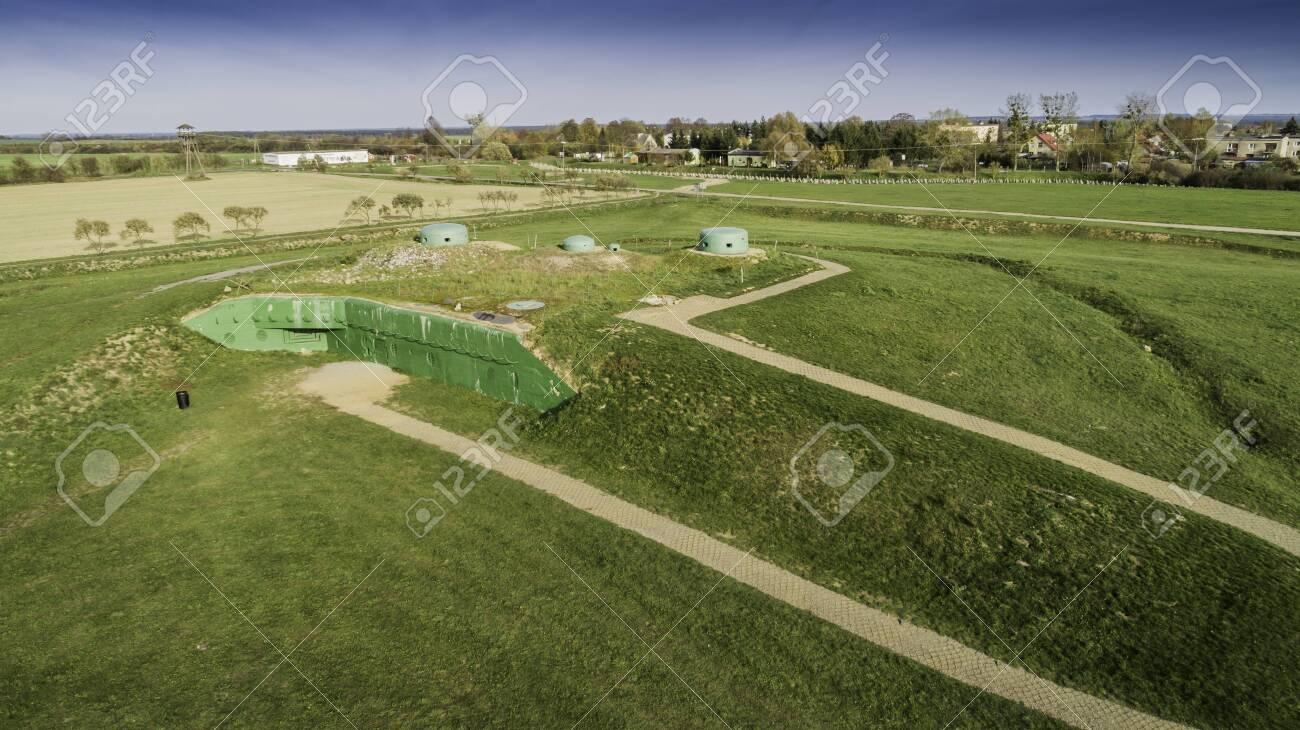 MRU World War II fortification bunker, Pniewo, near Miedzyrzecz, Poland. Entrance to the underground corridor system. German militarized zone from World War II. Aerial view. - 141148266