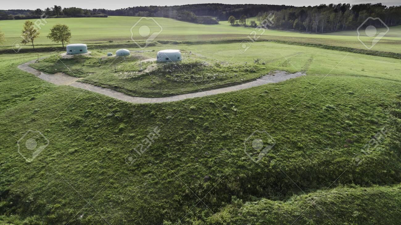 MRU World War II fortification bunker, Pniewo, near Miedzyrzecz, Poland. Entrance to the underground corridor system. German militarized zone from World War II. Aerial view. - 141148263