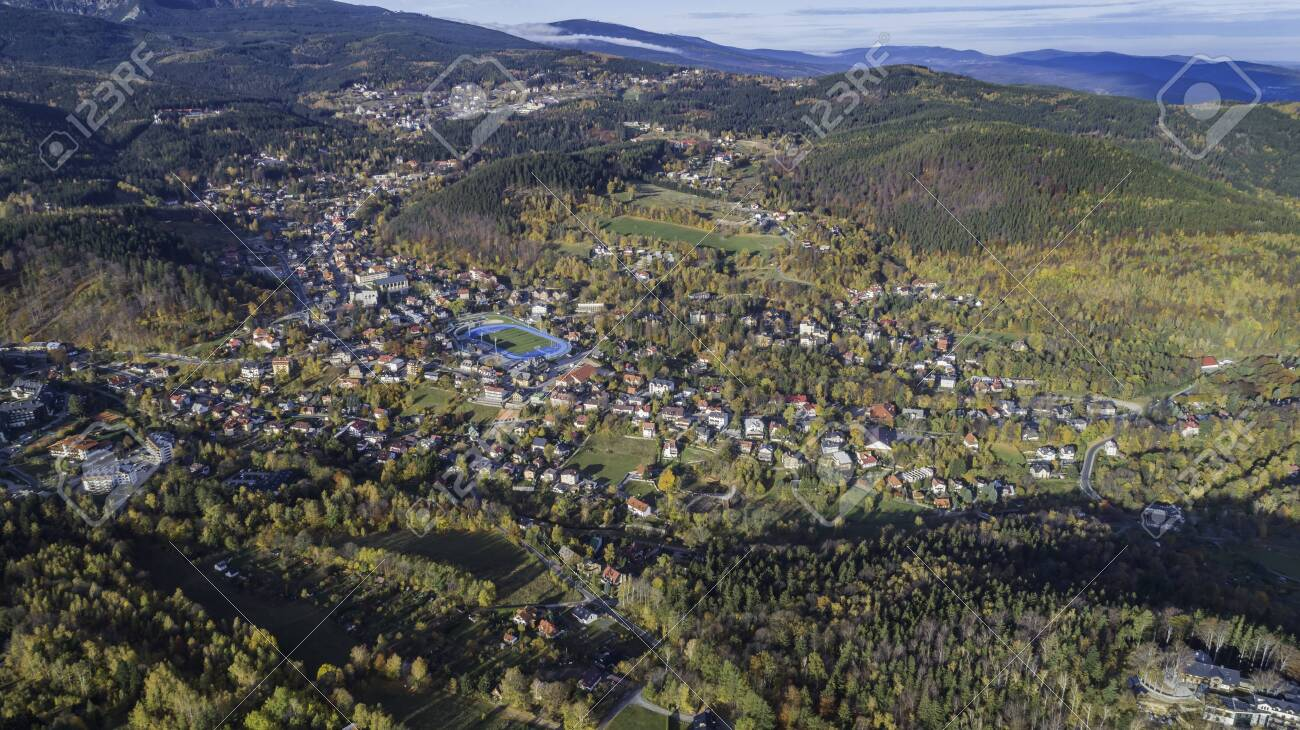 Aerial view of Karpacz city at the foot of Sniezka and the Karkonosze National Park - 141148716