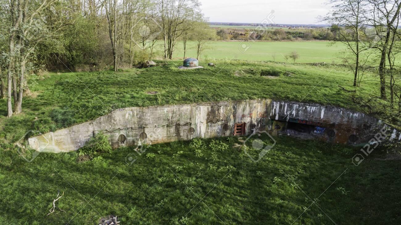 MRU World War II fortification bunker, Pniewo, near Miedzyrzecz, Poland. Entrance to the underground corridor system. German militarized zone from World War II. Aerial view. - 141148345