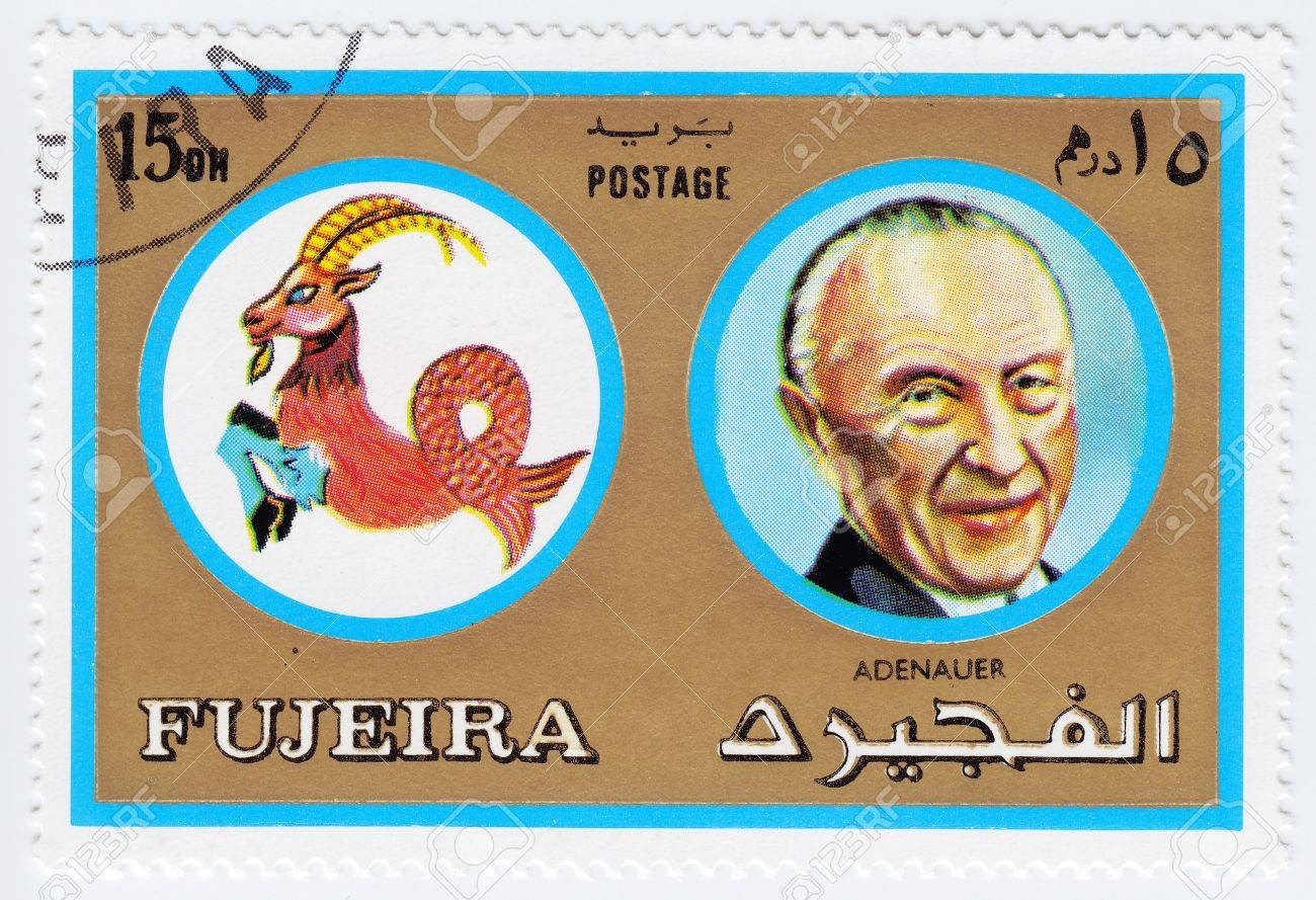 FUJEIRA - CIRCA 1971 : stamp printed in Fujeira, Zodiac Signs of Famous People  shows image of the German statesman Konrad Hermann Joseph Adenauer and Capricorn the sea goat, circa 1971  Stock Photo - 15767634