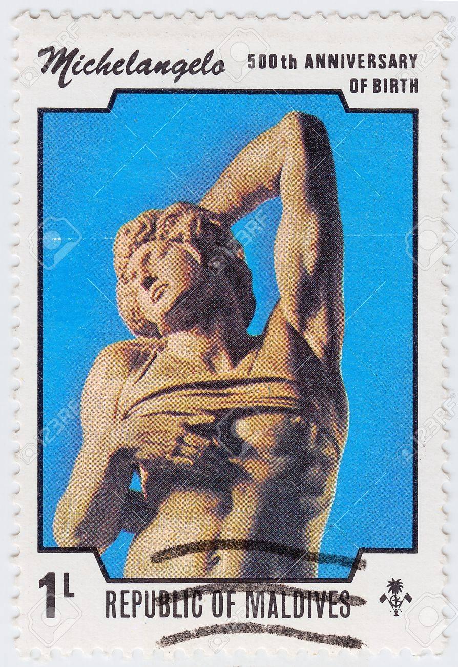 GRENADA - CIRCA 1975 : stamp printed in Grenada dedicated artist Michelangelo di Lodovico Buonarroti Simoni 500th Anniversary of birth, circa 1975 Stock Photo - 15908338
