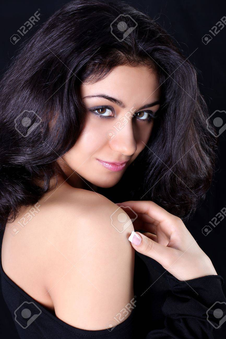 lovely woman against black background Stock Photo - 15962278