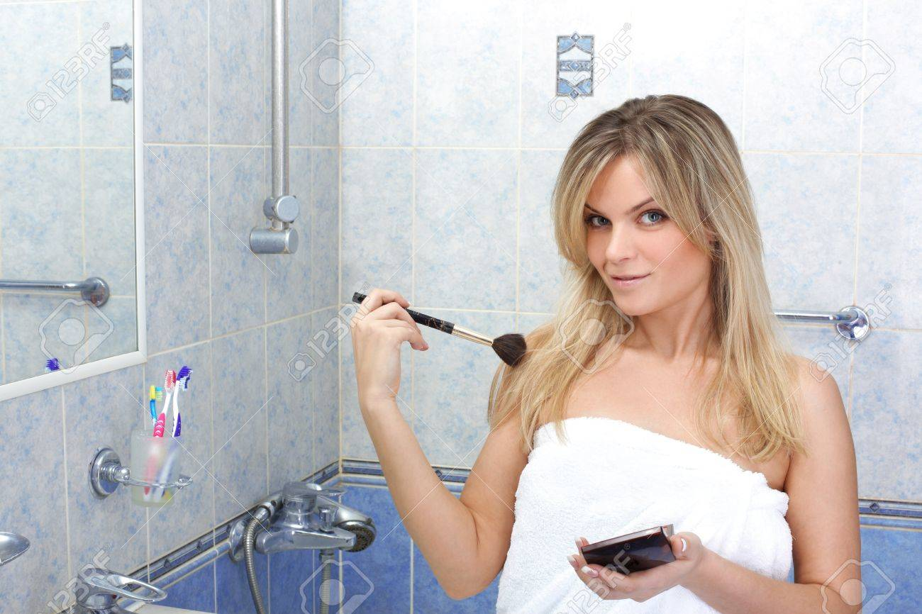 Young woman during daily morning routines Stock Photo - 15959669