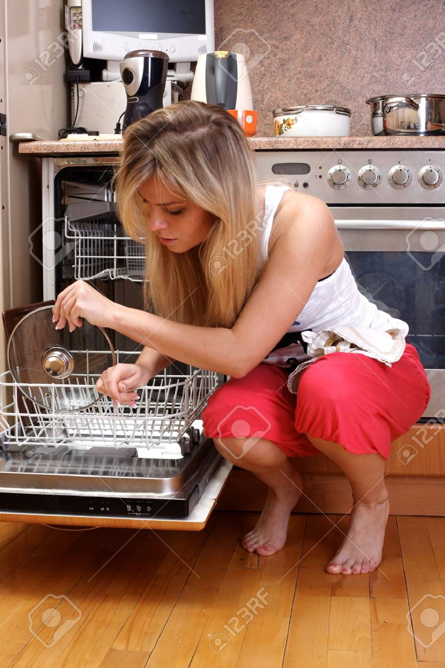 woman cleaning kitchen Stock Photo - 15960563