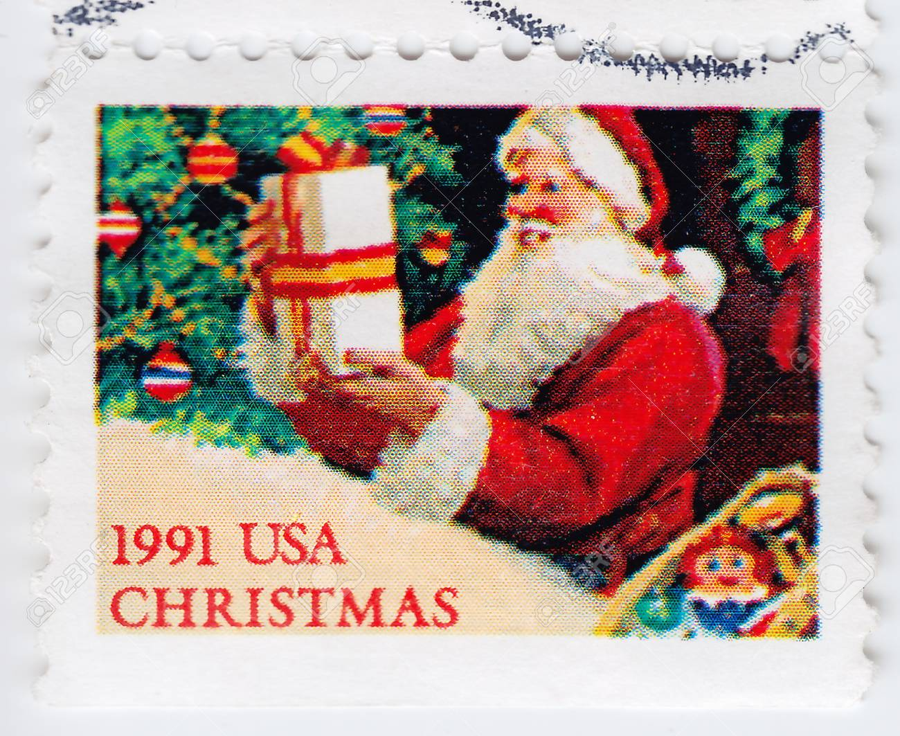 USA - CIRCA 1991 : stamp printed in USA shows Santa with gift, circa 1991 Stock Photo - 16393553