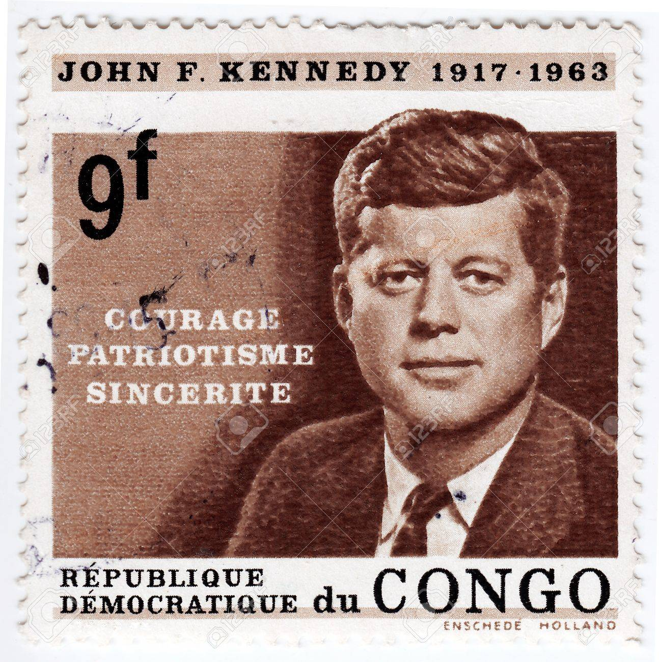 CONGO - CIRCA 1963   Stamp printed in Congo shows 35th president of USA - John Fitzgerald Kennedy, circa 1963 Stock Photo - 16376378