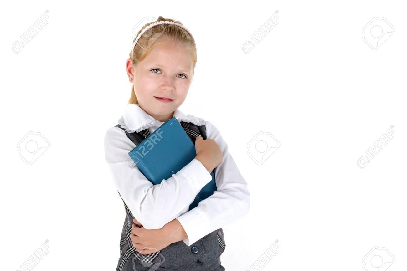 Fille De 8 Ans De L Ecole Avec Le Livre Souriant Sur Fond Blanc