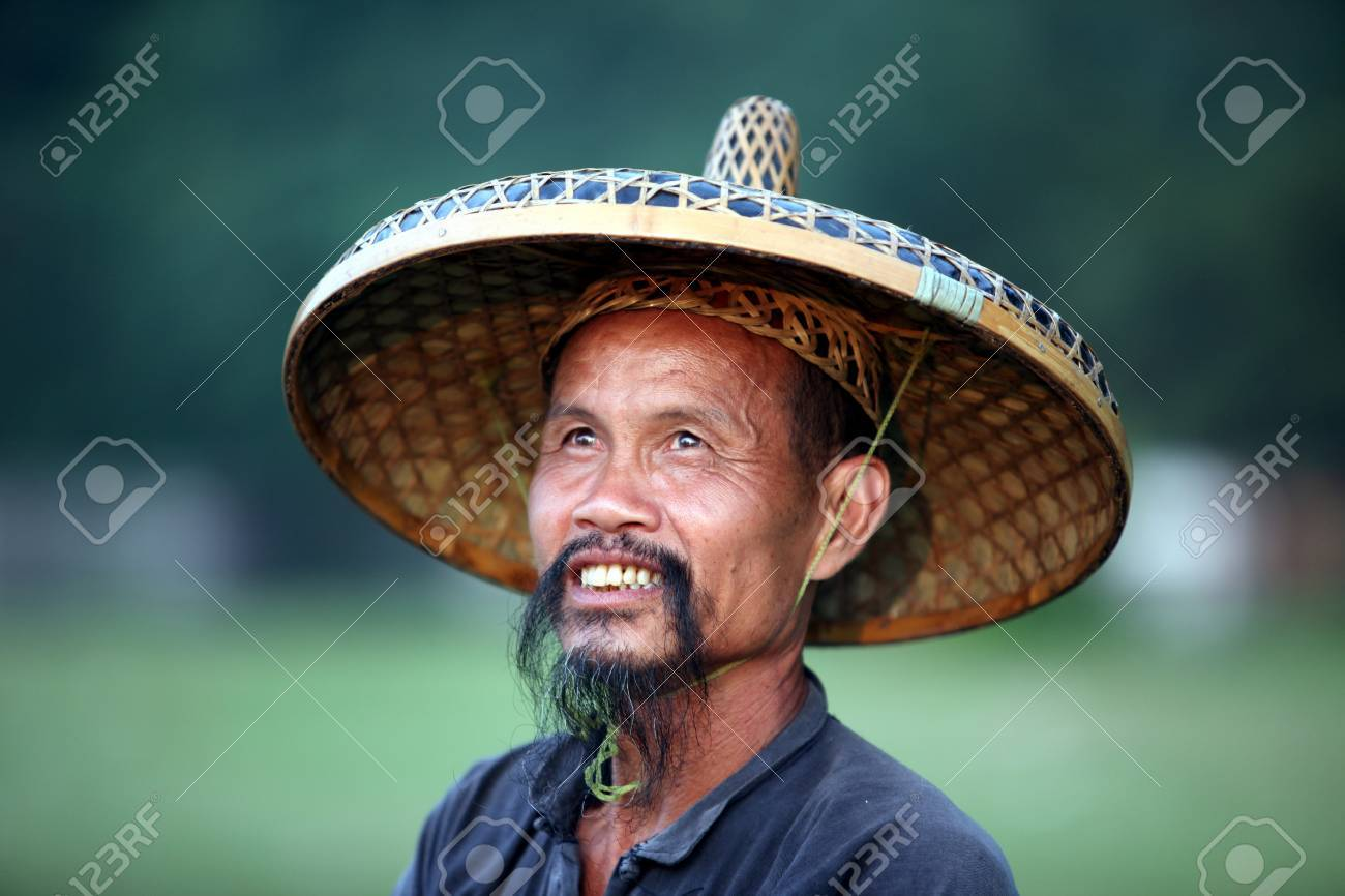 8878b7056 GUANGXI - JUNE 18: Chinese man in old hat in Guangxi region, traditional  type