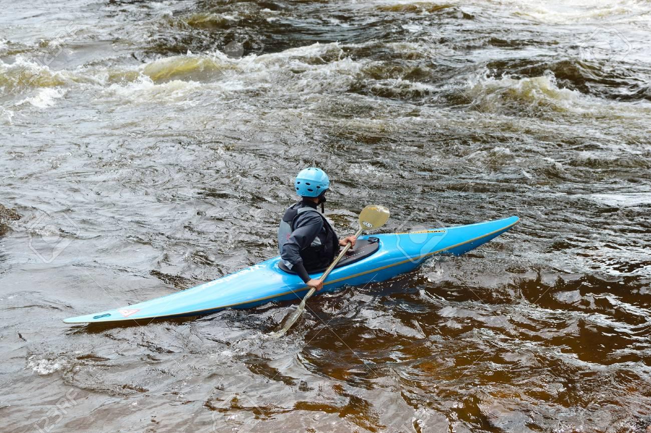 River Vuoksi, Leningrad Region, Russia - 3 July 2011: Kayaker sporting a kayak cuts through water. Stock Photo - 10792996