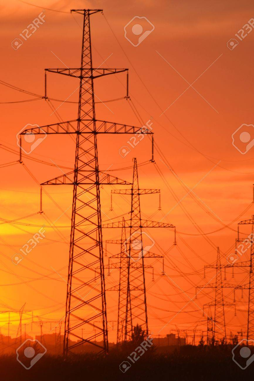 The photo of electric power transmission lines at sunset  Little noise Stock Photo - 15150082
