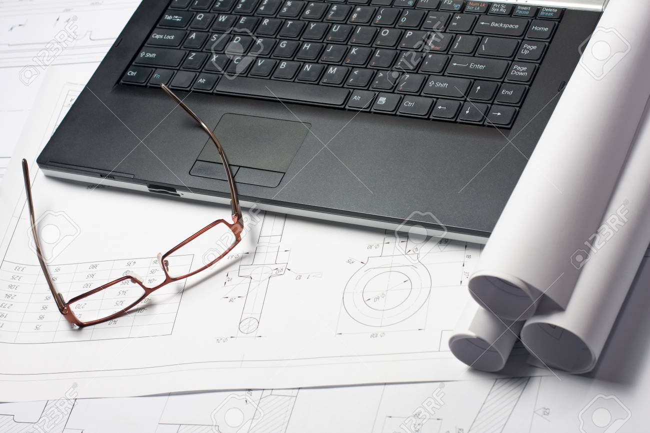 Rolled blueprints on the architect's worckplace near laptop and glasses Stock Photo - 13721205