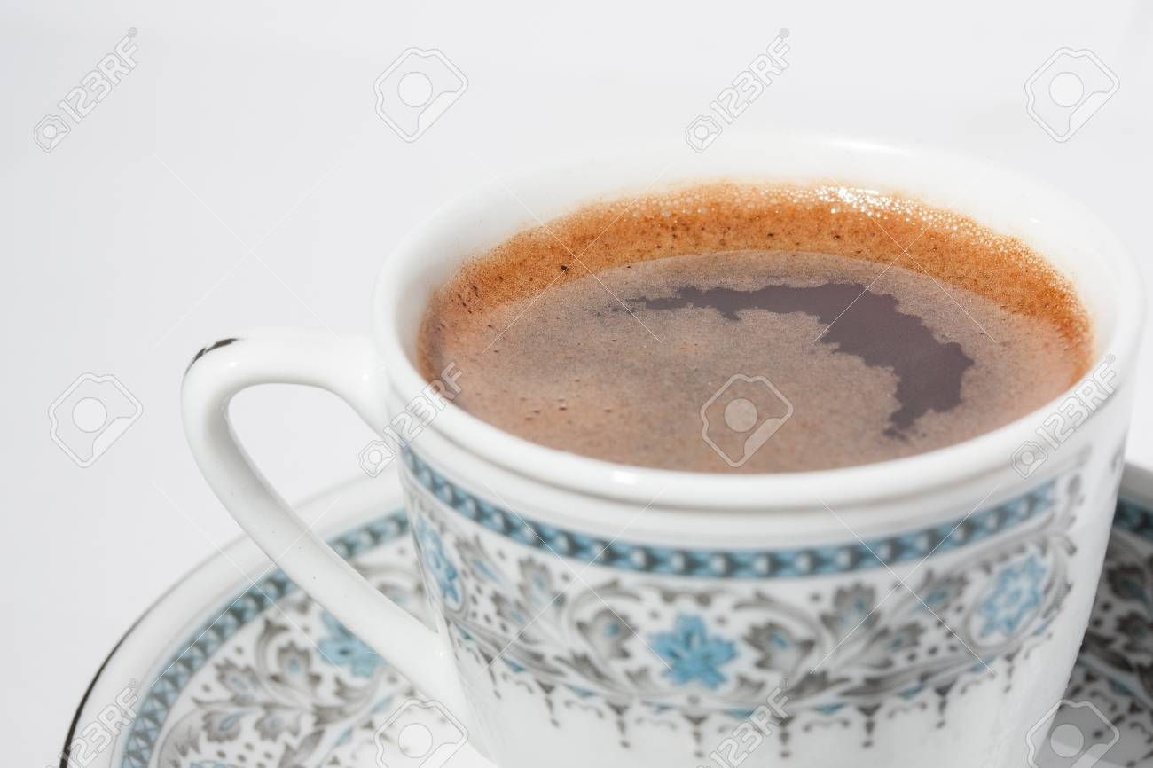 A cup of coffee with froth on white background Stock Photo - 17742884