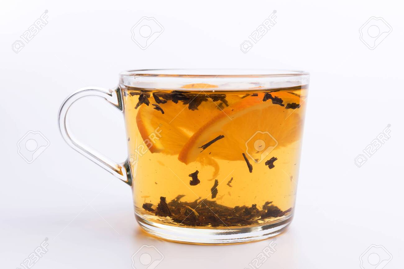 Glass cup of hot aromatic tea on white background - 121120300
