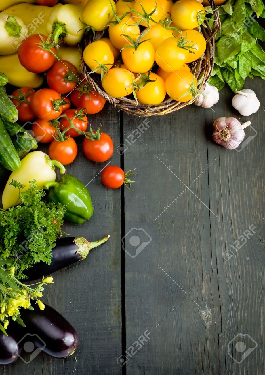 abstract design background vegetables on a wooden background - 10542278