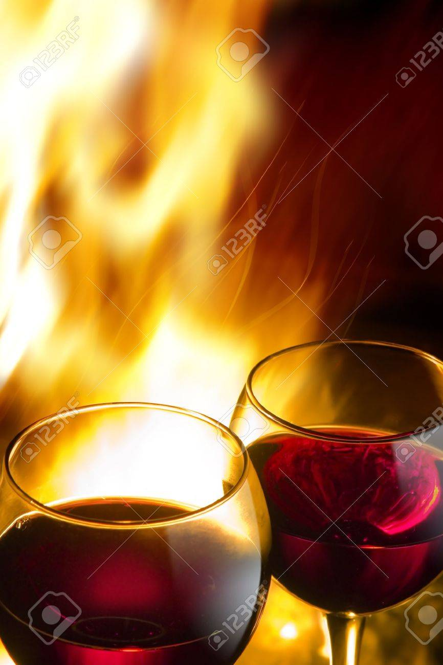 hot wine night, against the backdrop of a burning fire Stock Photo - 10542015