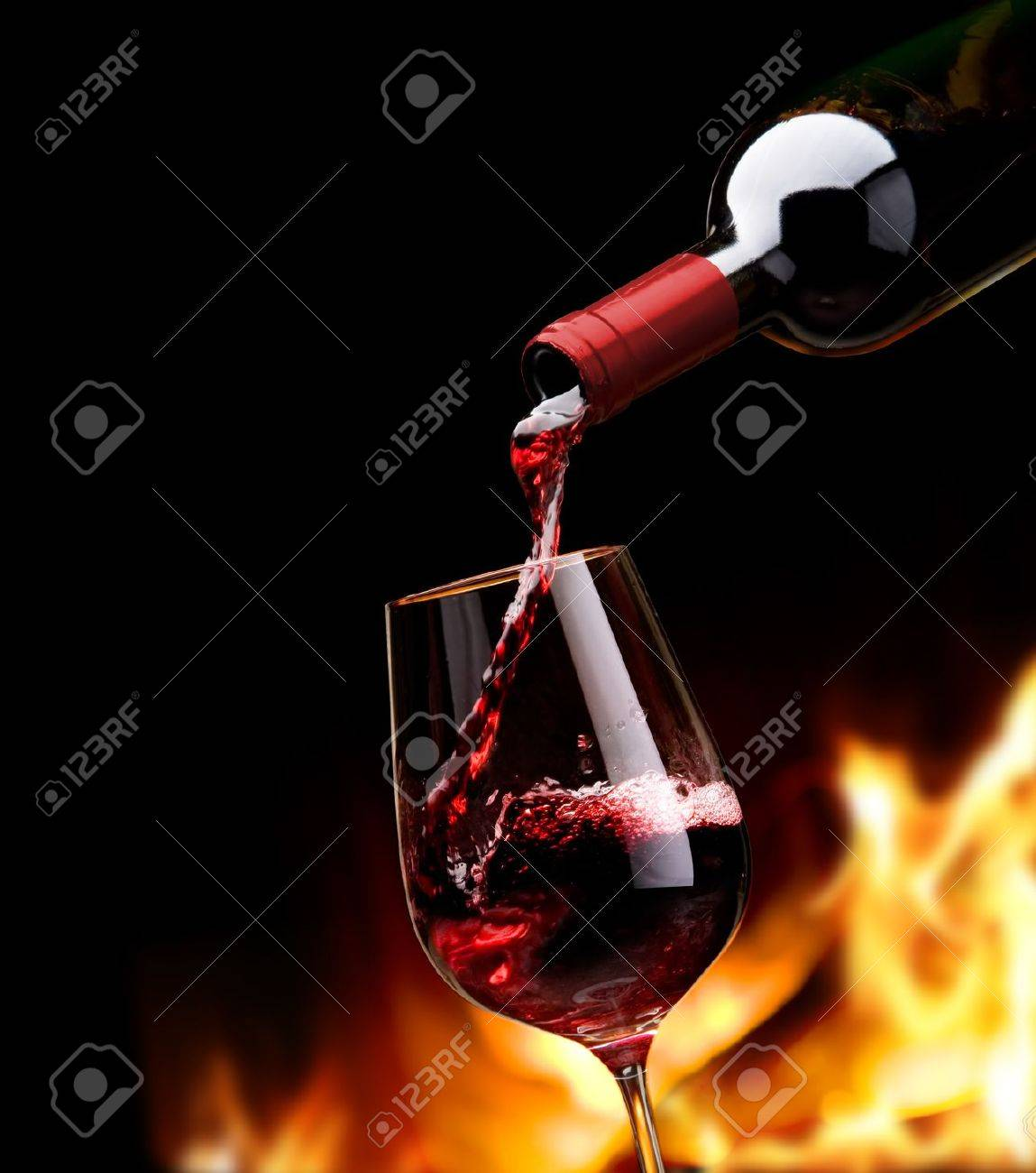 pouring wine by the fireplace Stock Photo - 10541915