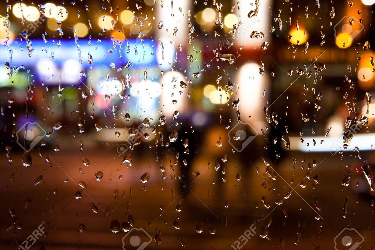 Wet the window with the background of the autumn night city Stock Photo - 10626828