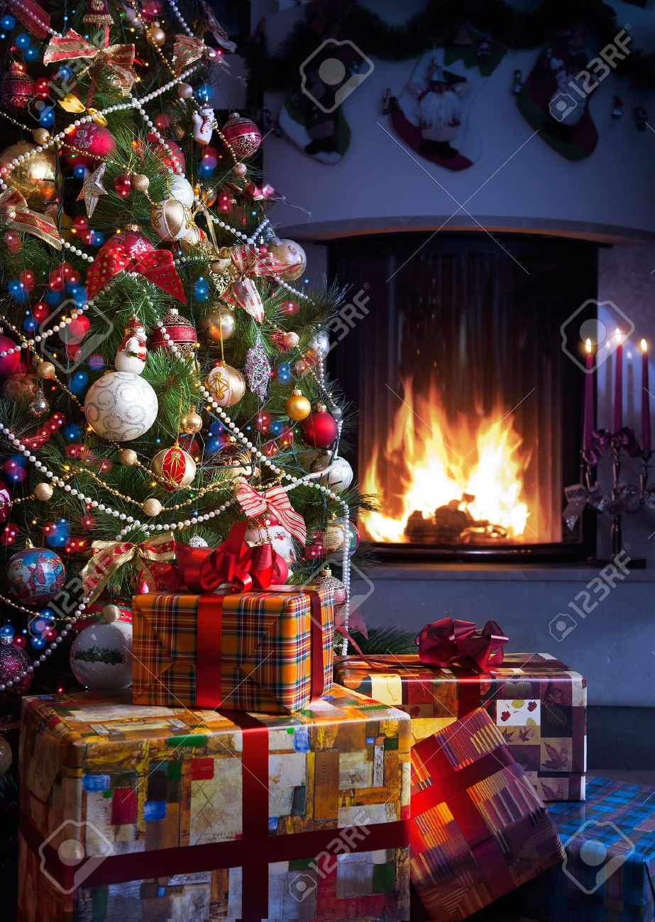 Christmas Tree and Christmas gift boxes in the interior with a fireplace Stock Photo - 10626829