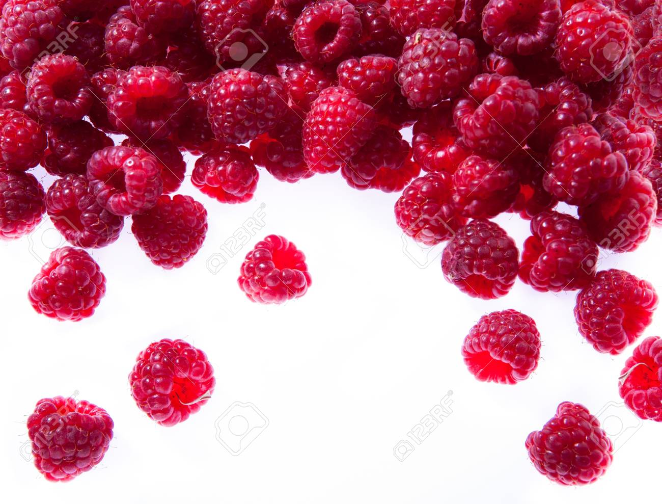 sweet red raspberries pour in the white background Stock Photo - 10671542