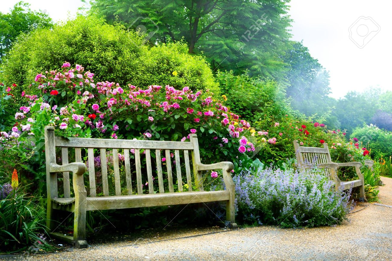 Art bench and flowers in the morning in an English park - 21861977