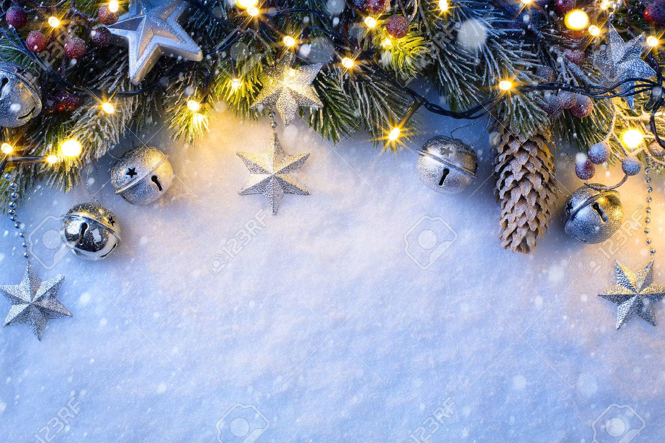 Christmas background with a silver ornament, christmas stars, berries and fir in snow Stock Photo - 48040623