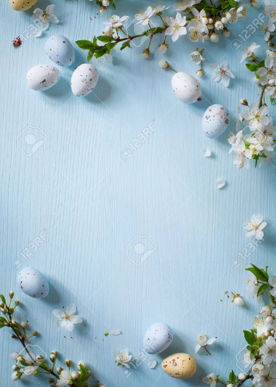 Easter eggs and spring flowers on wooden background Stock Photo - 52674410