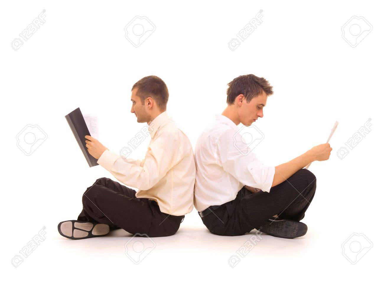 two businessmen sitting back-to-back. isolated on white Stock Photo - 3295242