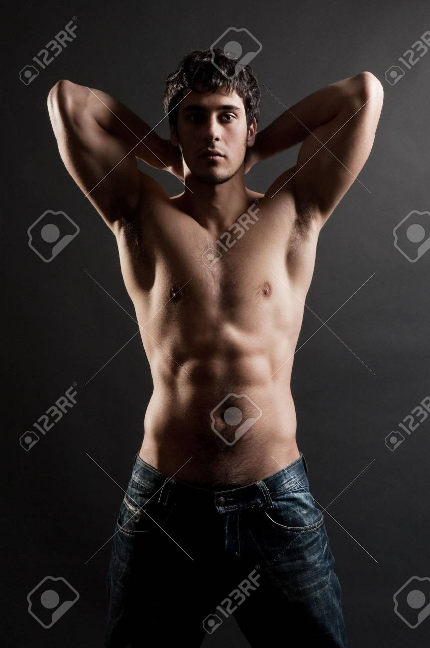 portrait of handsome muscleman against dark background Stock Photo - 4627486