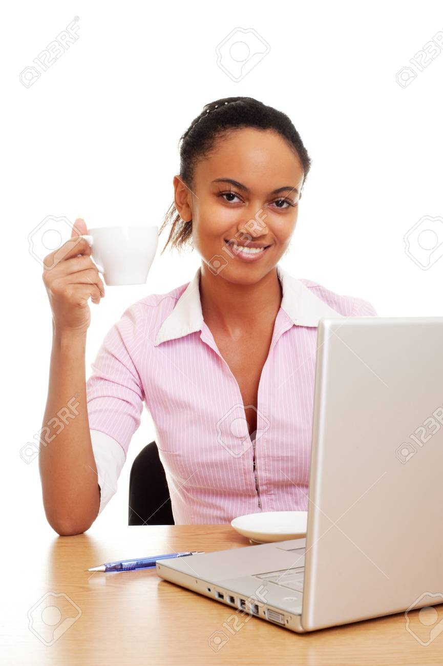 smiley student with cup of tea at her workplace Stock Photo - 6643745
