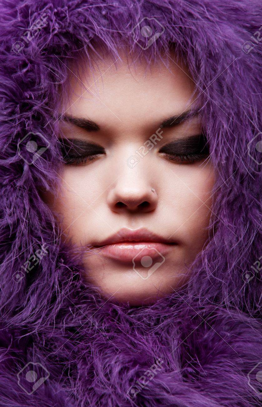 close-up portrait of young woman in violet fur Stock Photo - 8894538