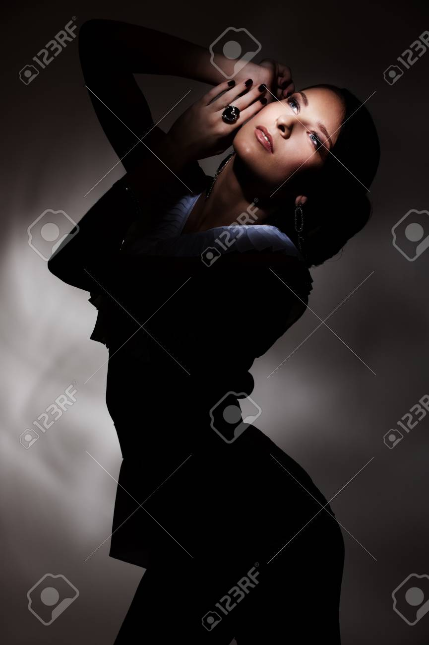 portrait of attractive young woman in dark Stock Photo - 8895016