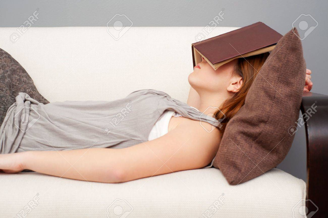 woman sleeping with book on her face Stock Photo - 9145791
