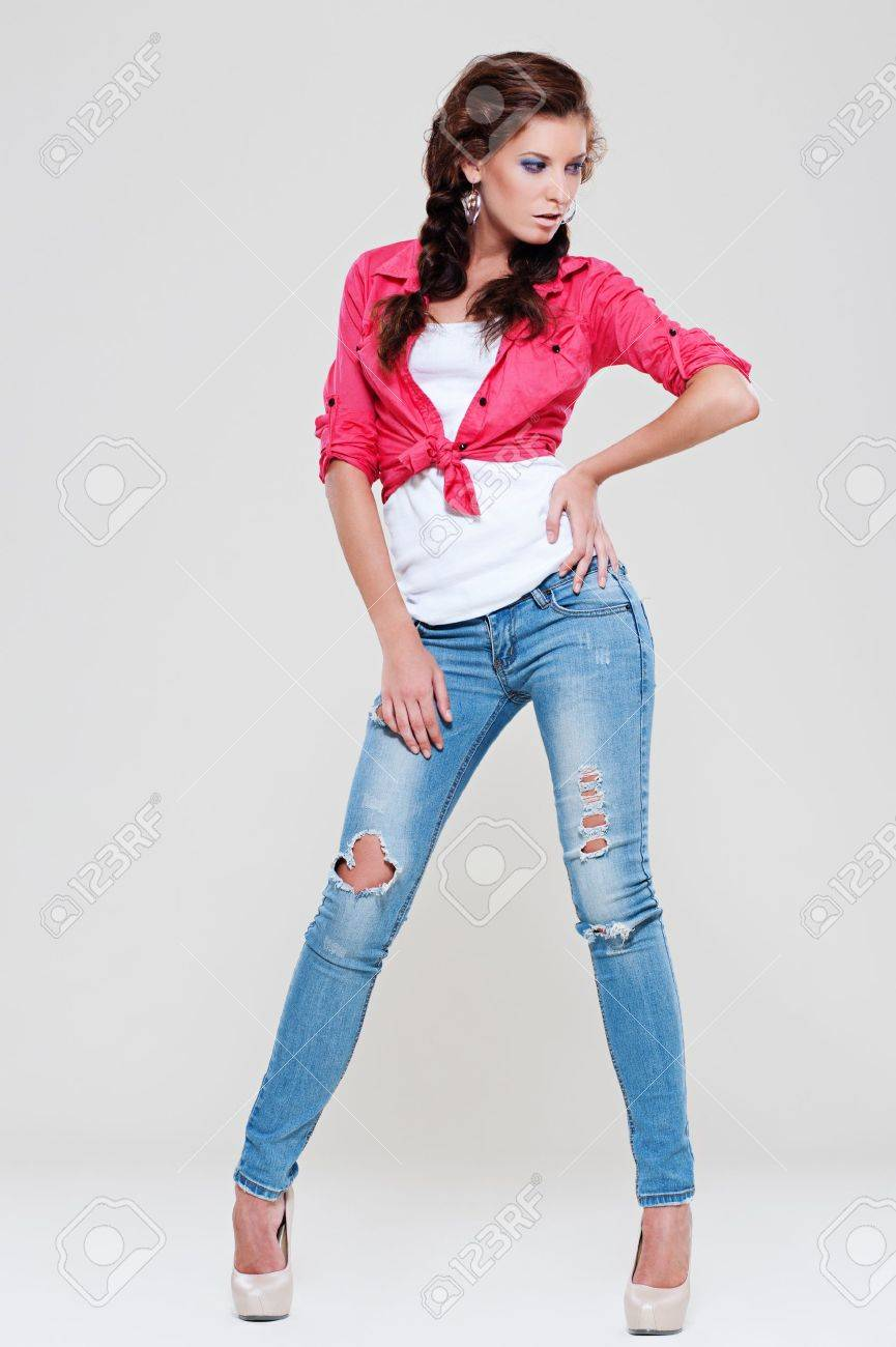 Portrait Of Sexy Woman In Blue Jeans And Red Shirt Posing Against Stock Photo Picture And Royalty Free Image Image 11638990