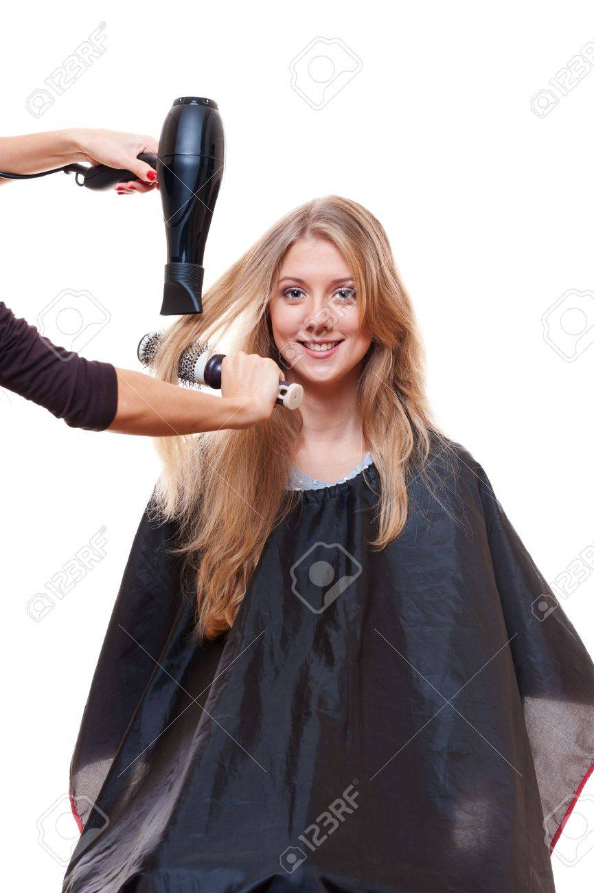 hairdresser blow dry hair. isolated on white background Stock Photo - 12428706
