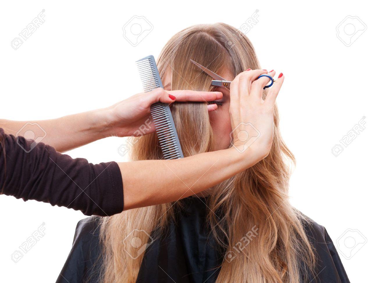 hairdresser cutting models fringe. isolated on white background Stock Photo - 12428743