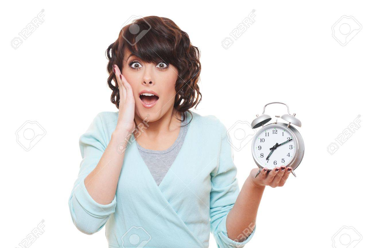 portrait of shocked woman with alarm clock over white background Stock Photo - 12428703