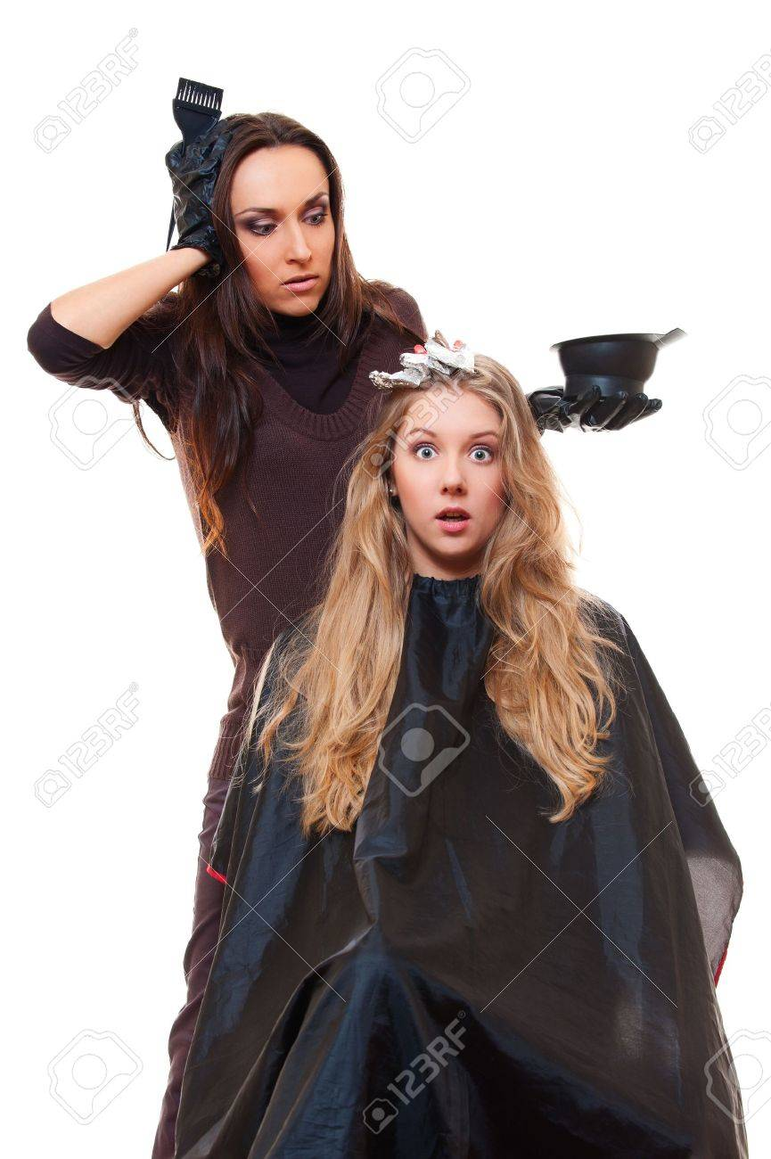 studio shot of hairdresser and shocked client. isolated on white Stock Photo - 13551618