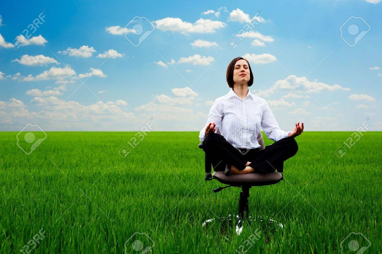 businesswoman practicing yoga at the meadow at sunny day Stock Photo - 13723203