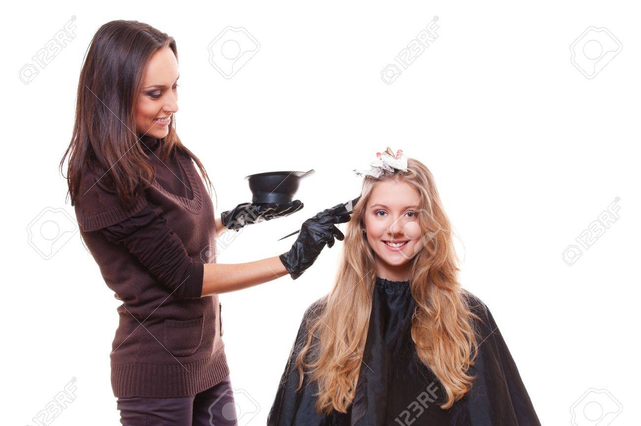 young stylist and blonde woman  studio picture over white background Stock Photo - 13723109