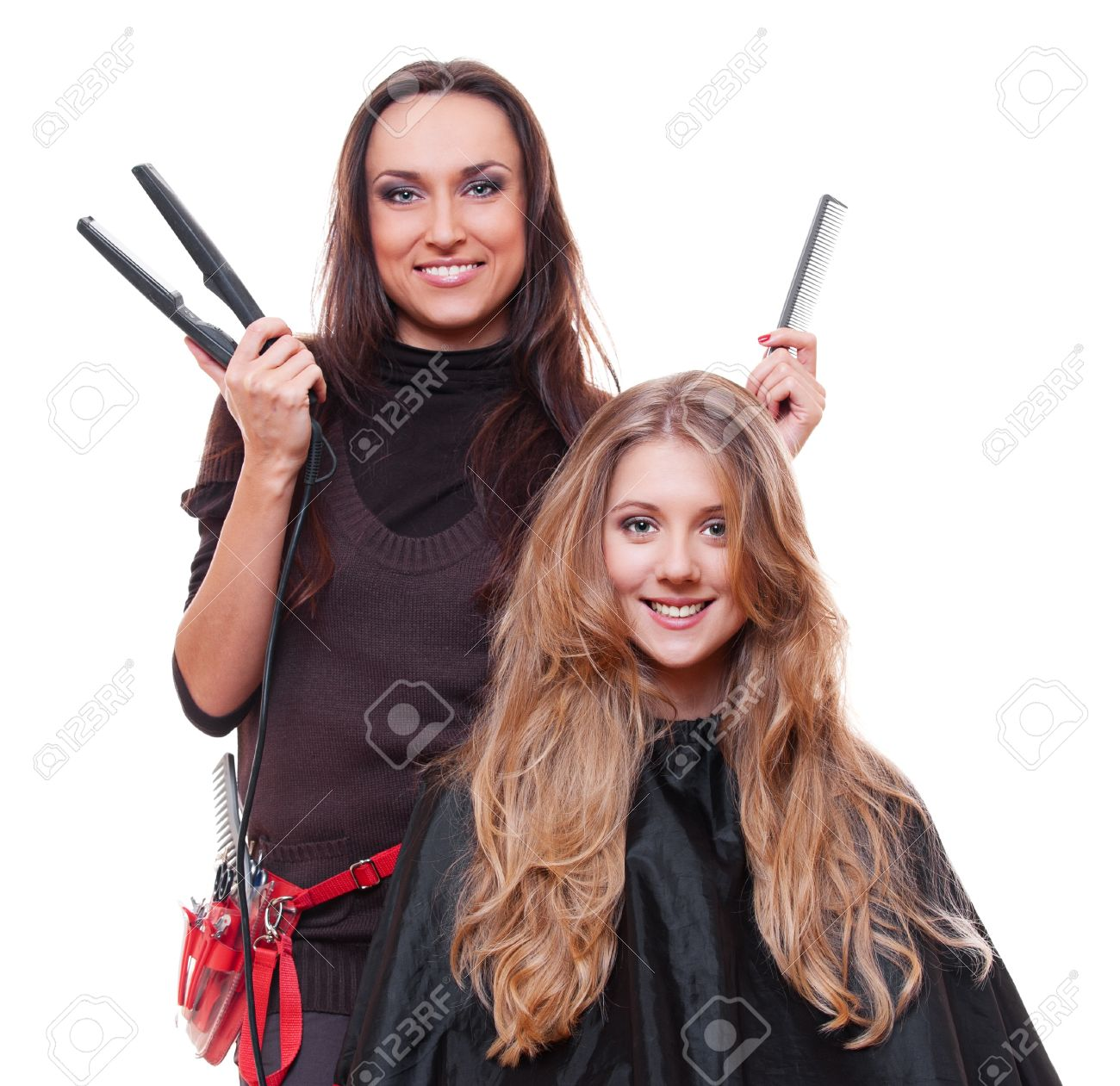 studio shot of smiley hairdresser with straighteners over white background Stock Photo - 13830494