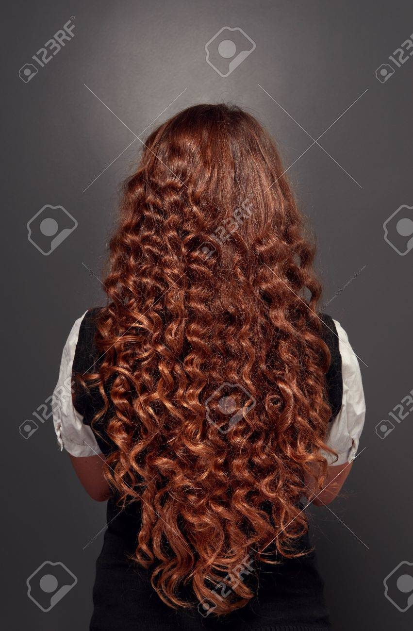 Back View Of Beautiful Natural Brunette With Long Curly Hair